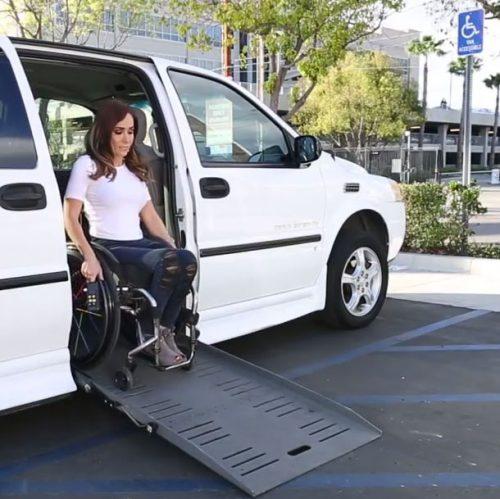 Tamara exiting her van using ramp